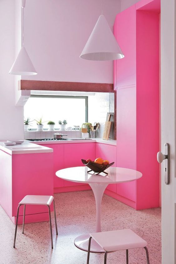 a super bold contemporary kitchen in bright pink and lavender for a colorful look