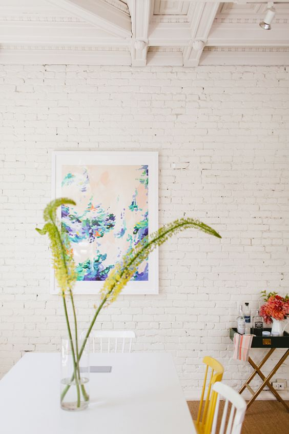 add interest to the space with brick walls and make them less rough and harsh with whitewashing