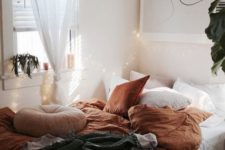18 fall-colored bedding in rust color and a dakr grey blanket to subtle embrace the fall