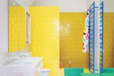 19 a color block upholstered ottoman plus a yellow hexagon tile wall in the shower make the bathroom stand out