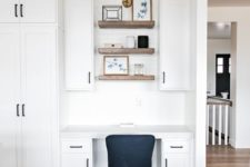 19 a modern farmhouse space with a seamless home office nook with cabinets, built-in shelves and a black chair
