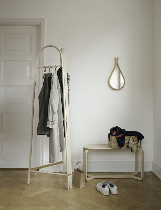a modern wooden coat rack with three sides and hooks for hanging everything you want