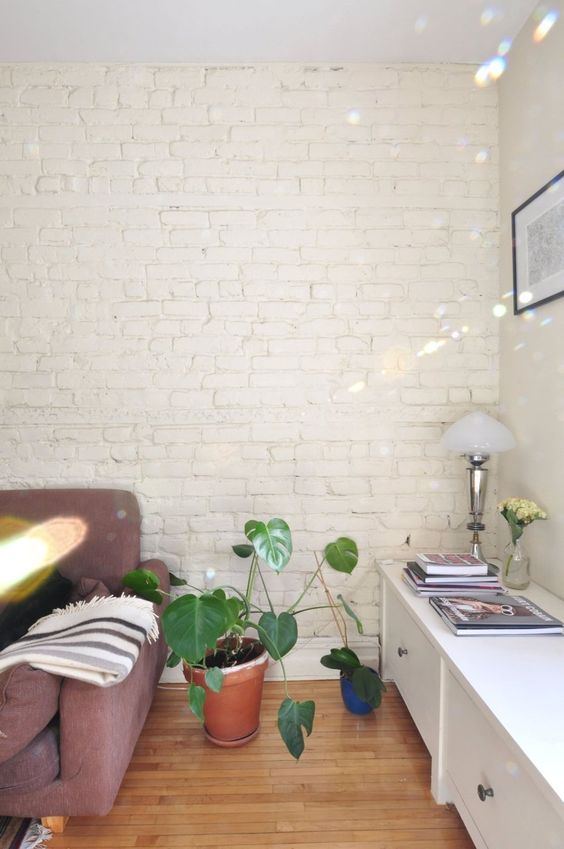 a whitewashed brick wall is a chic idea for any room to make an accent or to create a neutral backdrop for decor