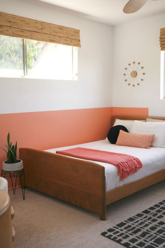 accent your sleeping zone with color blocking like here - a orange accent on the wall