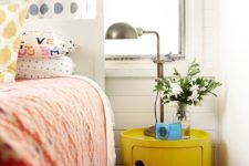 19 an ultra-modern yellow nightstand of a drum shape makes a statement with color