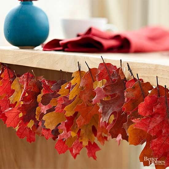 bring the beautiful autumn colors indoors by stringing freshly fallen oak leaves