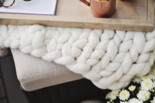 20 a chunky knit white blanket and copper mugs on a wooden tray are great for fall bedroom decor