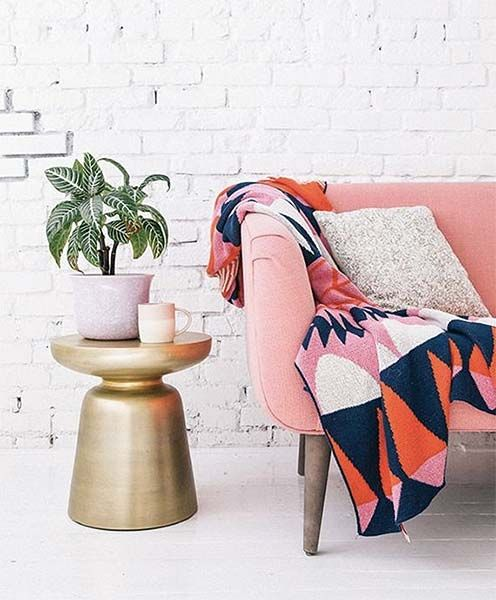 whitewahsed brick walls are a great backdrop for any colorful furniture and accessories