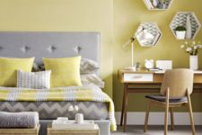 21 a pale yellow statement wall and matching pillows and a blanket for a colorful touch