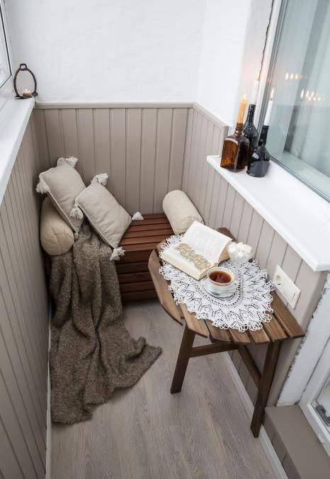a cool small balcony design with a half cut table