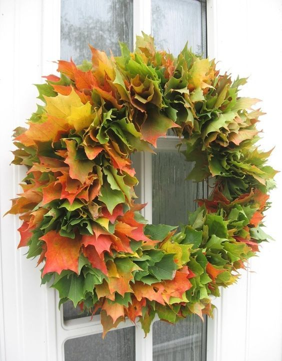 a super lush fall wreath made of real fall laves of various colors will make a statement both indoors and outdoors