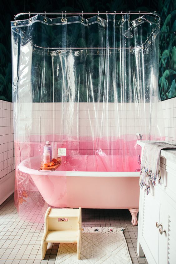 a transparent shower curtain with a pink color block element is a simple and catchy idea to try