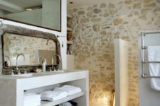 21 a whitewashed stone wall is a great accent for any bathroom, it brings a natural feel