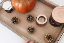 21 take a tray and display gilded pinecones and a pumpkin and some candles for a fall feel
