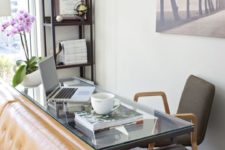 21 this home office nook uses the blind space behind the sofa, which is usually neglected, and a glass desk makes it airy