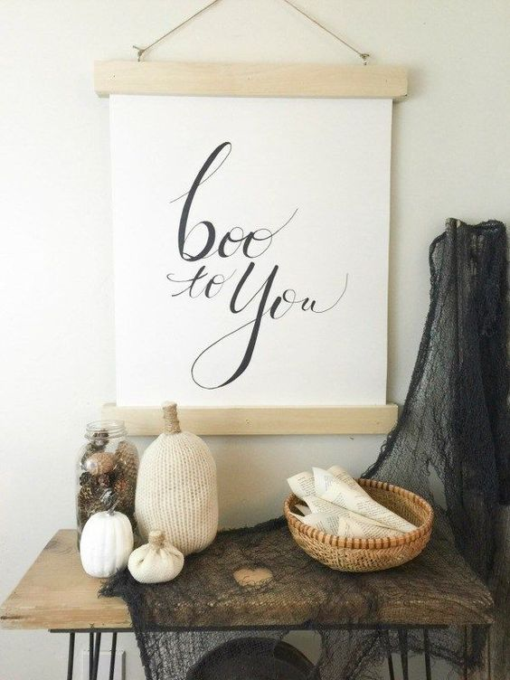a modern BOO sign of wood and paper with simple calligraphy or stenciling can be easily DIYed