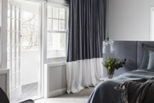 22 a monochromatic grey and white space with color blocking – a headboard wall and curtains