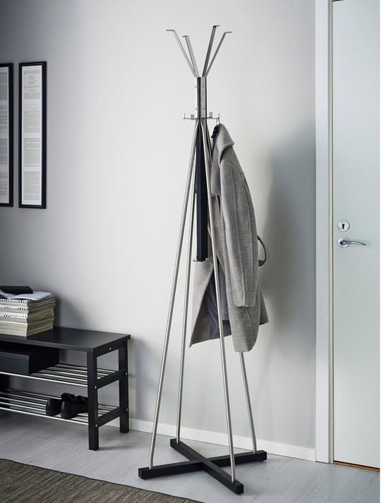 a stylish minimalist coat rack of plywood and metal looks airy and chic and doesn't take much space