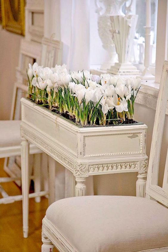 a vintage piano part turned into a refined and chic planter, which is ideal for a spring interior
