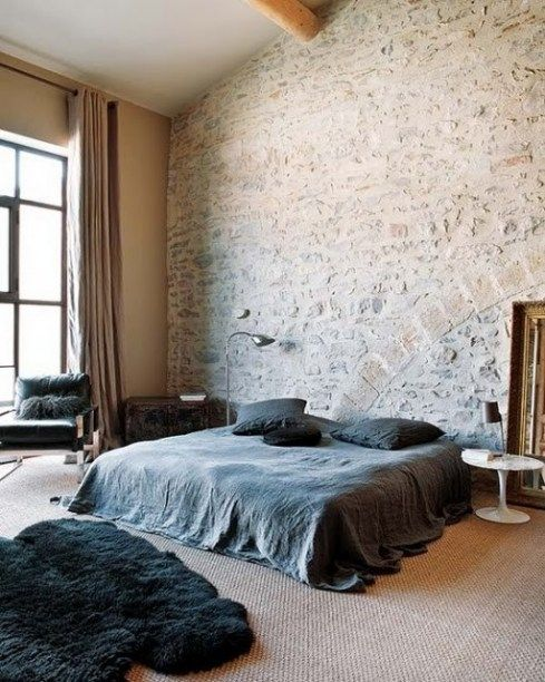add interest to your contemproray bedroom with a whitewashed stone accent wall