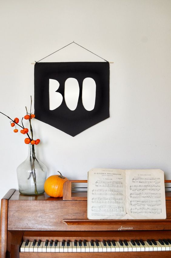 a simple BOO sign of black paper or fabric can be hung anywhere you want