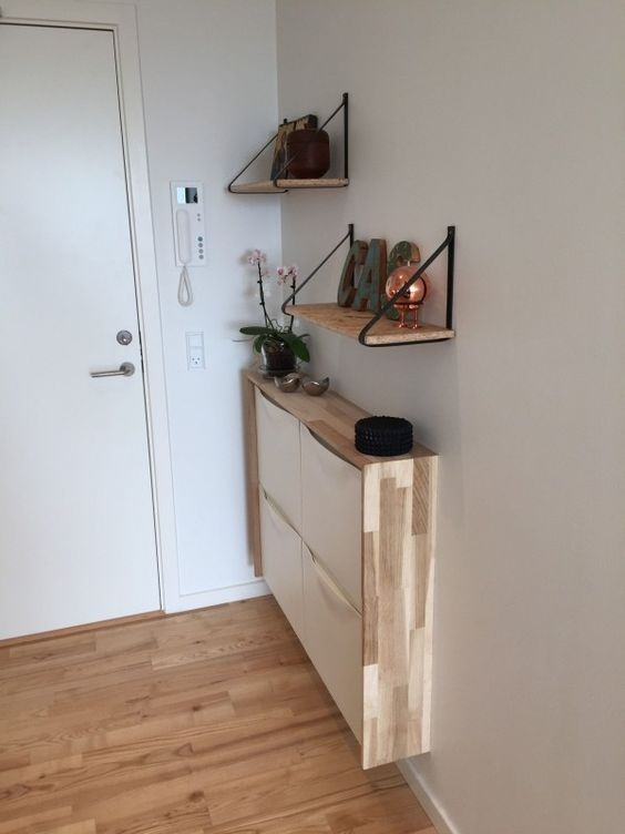 a very narrow floating console of an IKEA shoe cabinet with a plywood waterfall tabletop for a tiny entryway