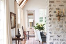23 a whitewashed stone wall is ideal for an antique or vintage space, it's gorgeous backdrop