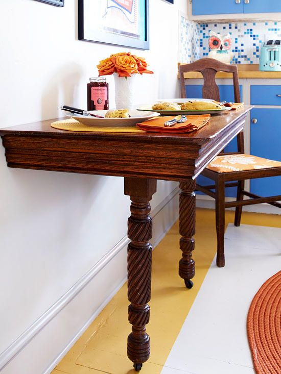 a wooden half table with casters is a great idea for small eat in kitchen like this one