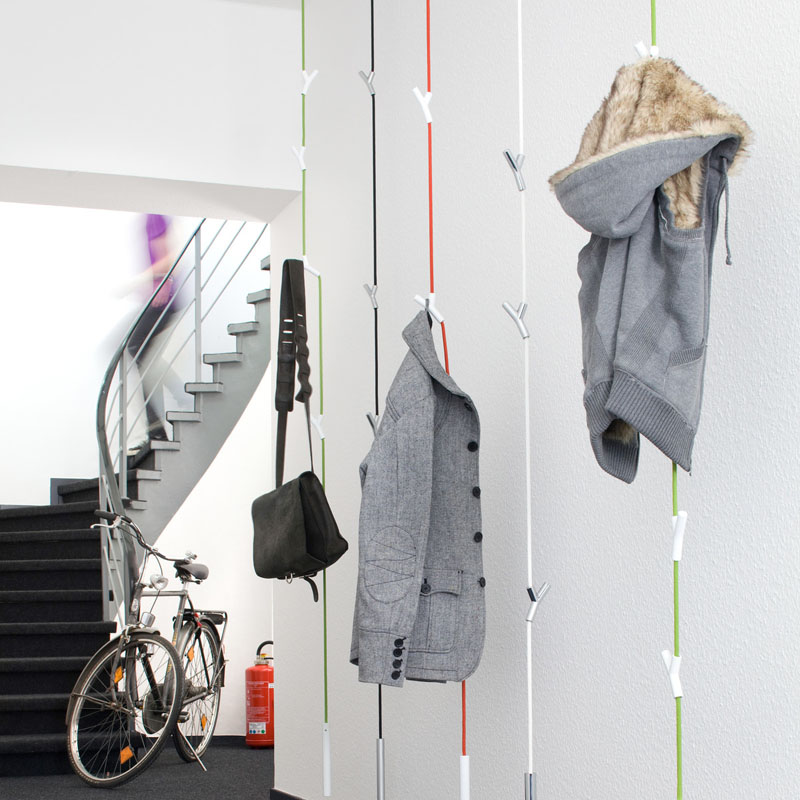 these hanging coat racks have 4 adjustable Y shaped hooks to hold your coats and bags and a weight at the bottom to keep the rack from swaying too much
