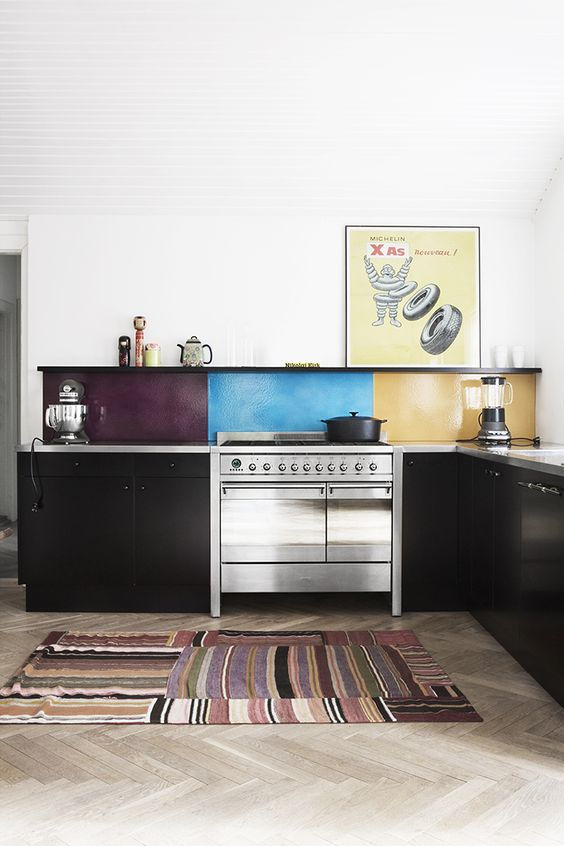 a black kitchen is spruced up with a bold idea, a color block kitchen backsplash