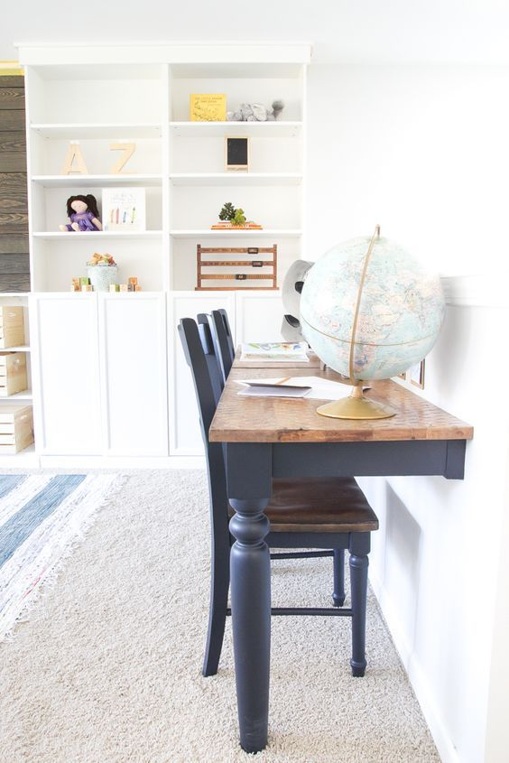 an old kitchen table turned into a double desk for a kids' room