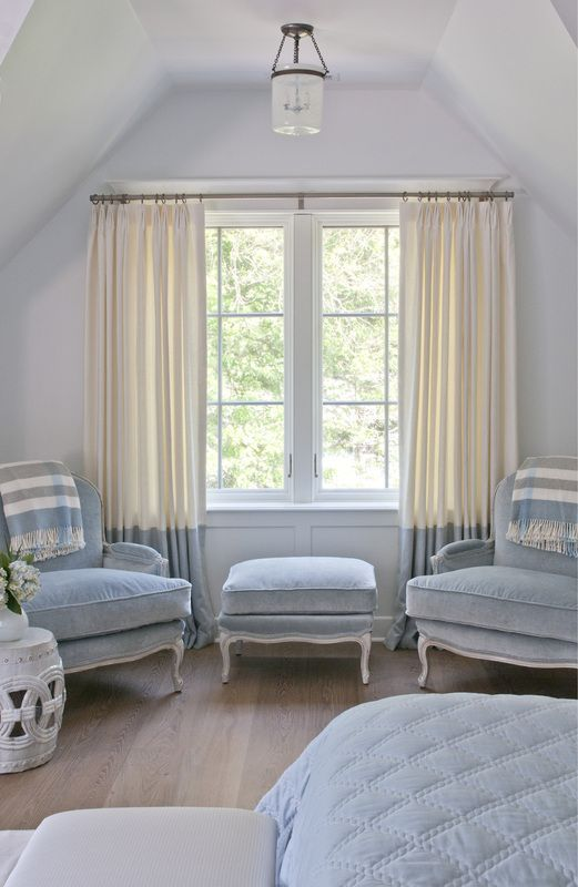 color block curtains in cream and powder blue matches the color palette and adds an edgy feel