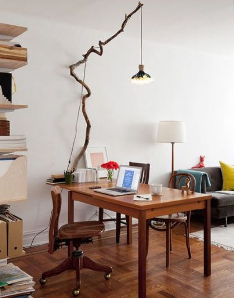 light up your space in an original way hanging some lights on a long tree branch over your desk
