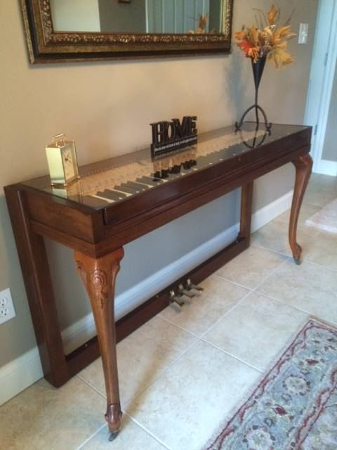 Wurlitzer piano with beautiful legs repurposed into a creative and chic console for an entryway