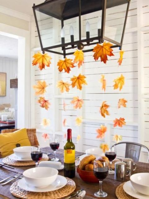 if you have a chandelier hanging over the table, hang some fall leaves on threads down