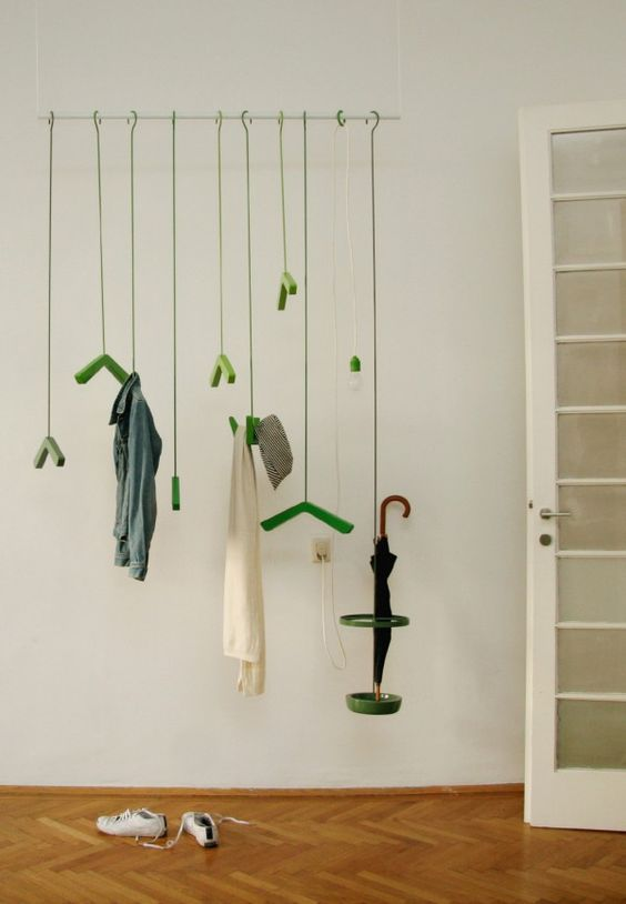 make a colorful and whimsy statement with such a coat rack hanging from above and colorful hooks and hangers