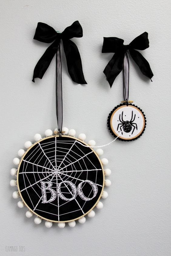 modern Halloween hoop art with spiderweb and a spider, pompoms and large bows