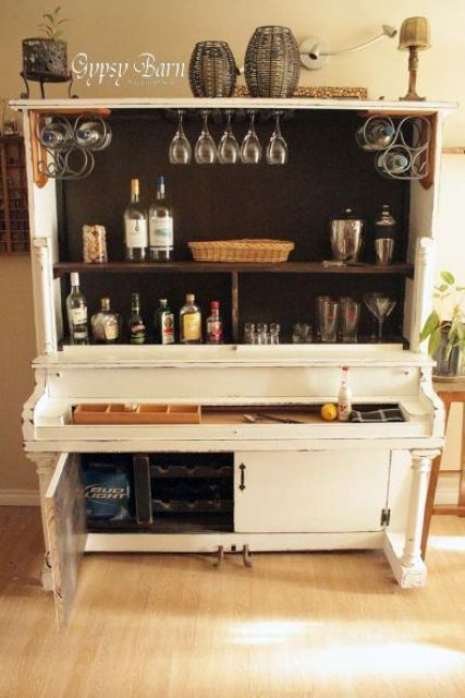 a home bar in white made of an old piano is a cool and bold idea that guarantees an original look
