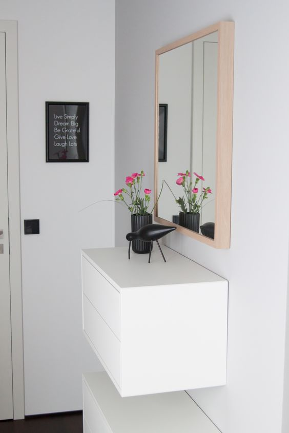 buy a plain IKEA cabinet and attach it to the wall, and a cool floating console with a contemporary feel is ready