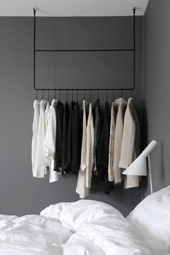 hang a rail to make your clothes part of your bedroom decor