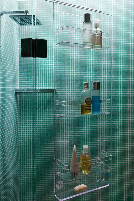 an acrylic shower caddy looks ethereal and floating in the air