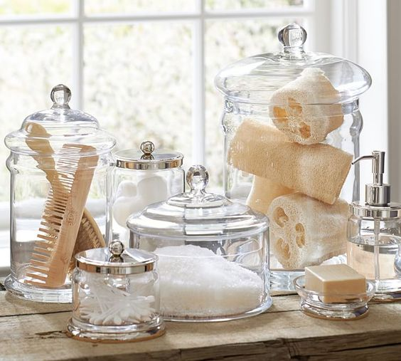 classic glass containers with lids are ideal for storing bathroom stuff