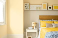 25 pastel yellow walls and bright yellow bedding and pillows create a very warm ambience