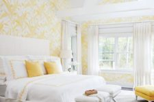 26 yellow and white wallpaper with botanical prints, yellow pillows and an ottoman for a sun-filled look