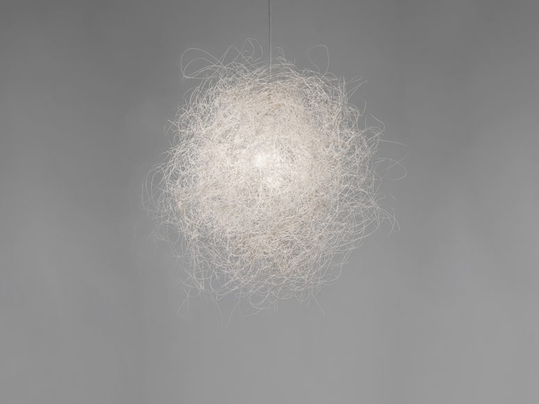 Pili is a unique lamp that resembles a cloud, it's composed of a single stainless steel thread interwoven