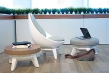 01 Sway Chair is a super comfortable lounging chair with a matching footrest and a coffee table for contemporary spaces
