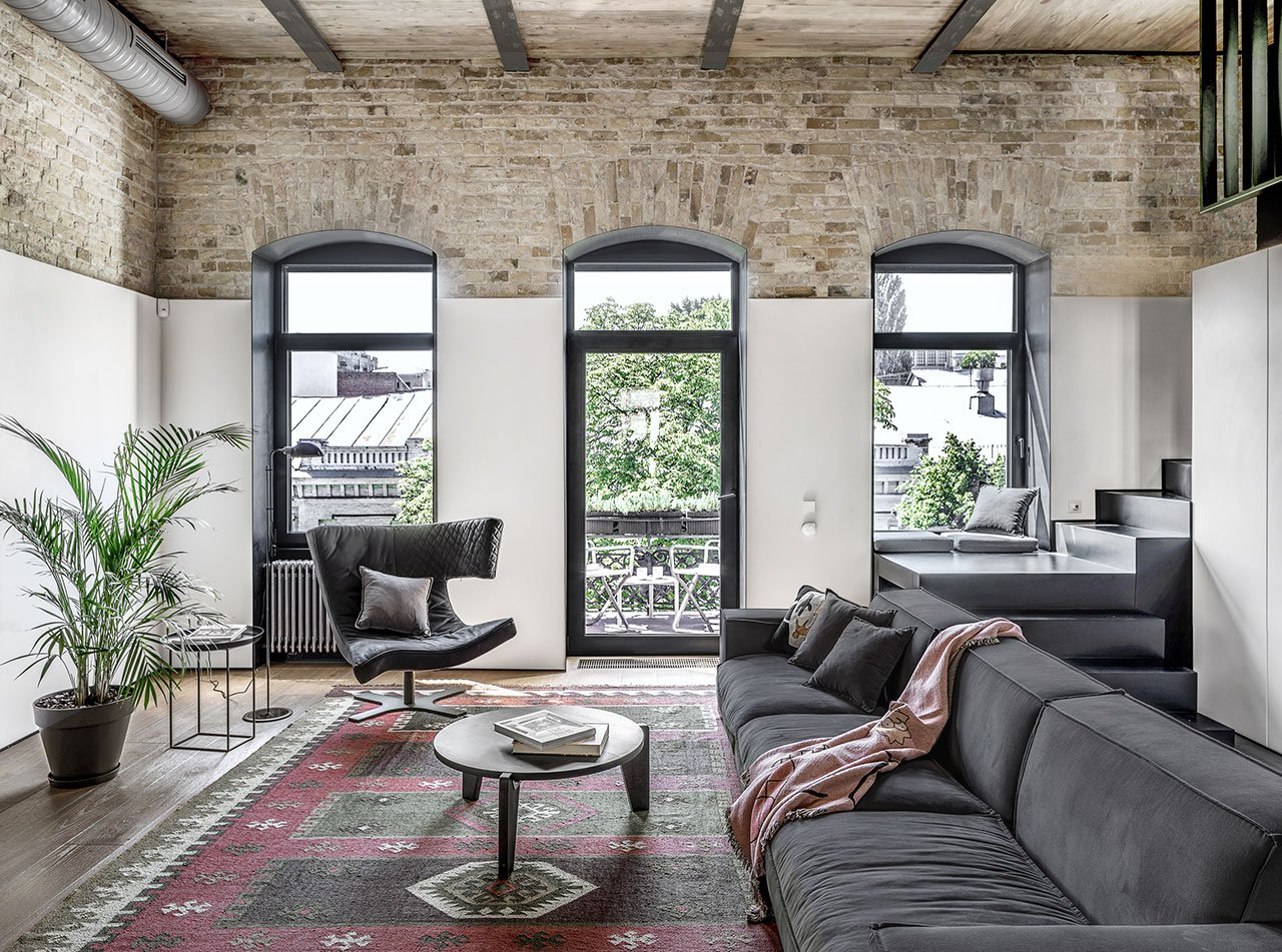 This minimalist apartment is done with an industrial feel for a young specialist