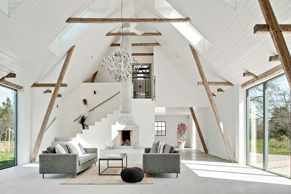 This modern home is a 100 old renovated barn, and the original structure was preserved yet renovated