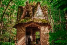 01 This tiny moss covered cabin looks like out of a fairytale, it's fully built of wood and features many windows