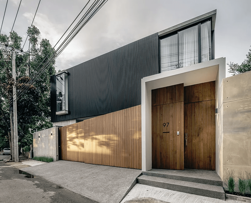 This ultra modern residence is built for an extended family and faces the old home on the same plot